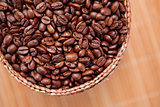 Roasted coffee seeds in a basket