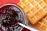 Breakfast with waffles and jam