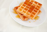 Waffles spread with honey