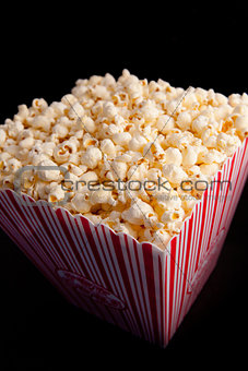 Close up of a box full of pop corn