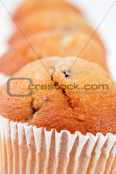 Close up on four muffins in line