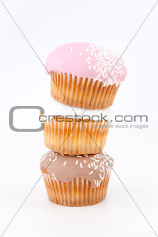 Three muffins with icing sugar piled up