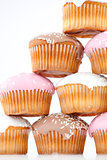Close up on eight muffins with icing sugar placed in pyramid