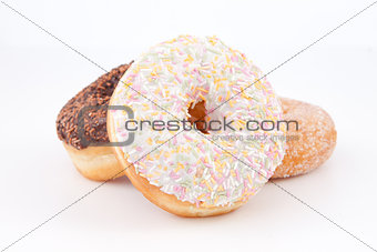 Three doughnuts with icing sugar