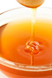 Close up of a thin honey trickle