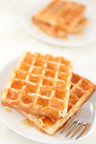 Waffles spread with honey in a plateful 