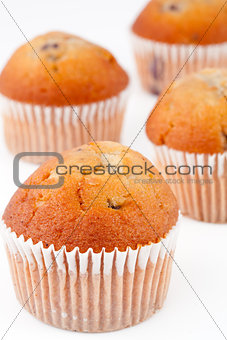 Four small baked muffins