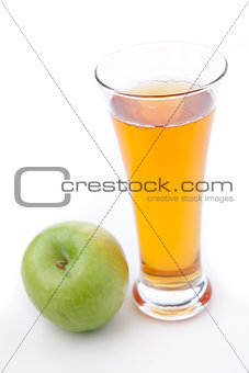 Apple place near a glass of apple juice