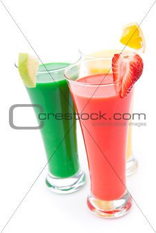 Three full glasses with fruit pieces