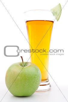 Apple near a glass of apple juice