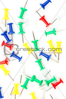 Close up of large group of multi coloured pushpins
