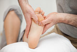 Chiropodist touching the foot of a woman
