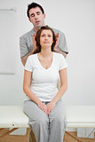Woman sitting while being manipulated