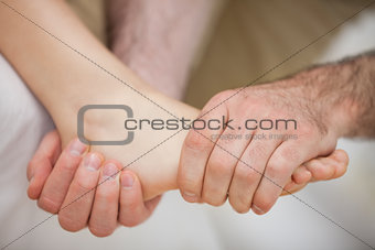 Foot being held by a practitioner