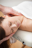 Neck of a patient being massaged by a chiropractor
