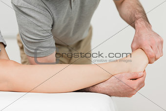 Physiotherapist stretching the ankle of a patient