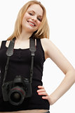 Joyful woman holding a camera