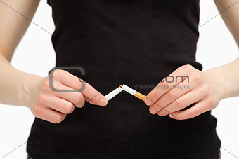 Close up of hands breaking a cigarette