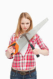 Woman holding a saw and a hammer