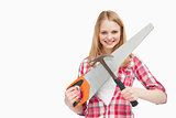 Woman holding a hammer and a saw
