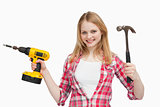 Smiling woman holding tools