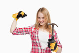 Joyful woman holding a hammer