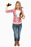 Woman standing while holding a hammer