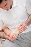 Reflexologist massaging the sole of the patient