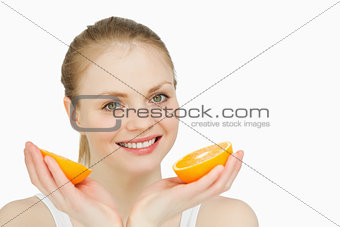 Smiling woman holding oranges