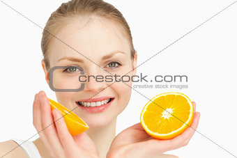 Close up of a joyful holding oranges