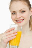 Cheerful woman holding a glass of orange juice
