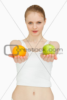 Woman presenting fruits