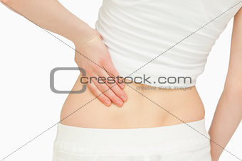 Close up of a woman massaging her back