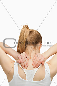 Blonde woman massaging her painful neck