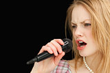 Woman singing while frowning