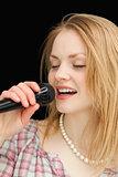 Woman singing while closing her eyes