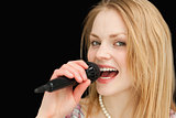 Young blond-haired woman singing