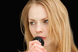 blond-haired woman singing