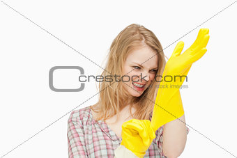 Angry woman wearing cleaning cloves