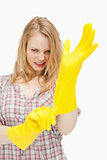 furious woman wearing cleaning gloves