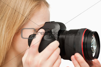 Close up of a young woman holding a camera