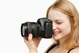 Smiling woman holding a camera
