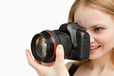Cheerful woman shooting with a camera