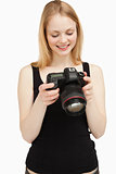 woman looking at her camera wile smiling