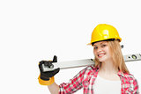 Woman smiling while holding a spirit level