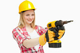Cheerful woman using an electric screwdriver
