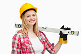 Smiling woman holding a spirit level