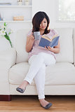 Woman reading a book while holding a mug