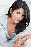 Close up of a woman holding a tablet