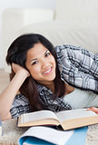 Close-up of a smiling woman holding a book